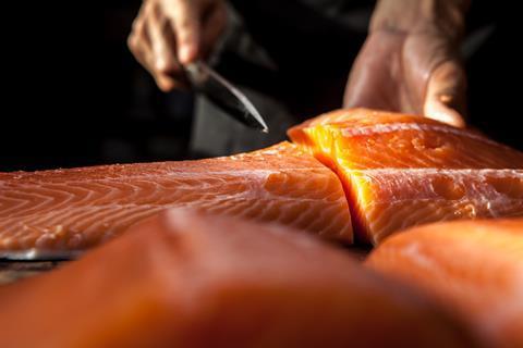 Chef preparing salmon