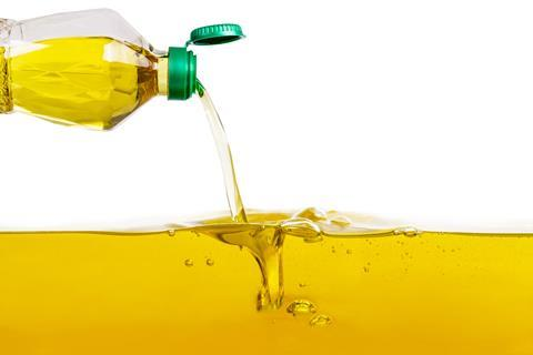 Bottle of vegetable oil pouring out