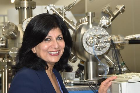 A photograph of Rasmita Raval in the lab