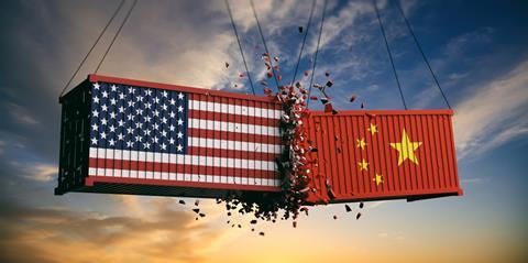 An illustration of cargo containers painted with US and Chinese flags crashing into each other, representing the trade war between the two countries