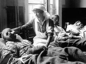 A nurse tends to a World War I victim
