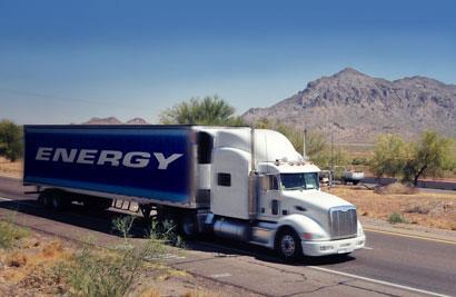 lorries-travelling-across-a-desert-road_410